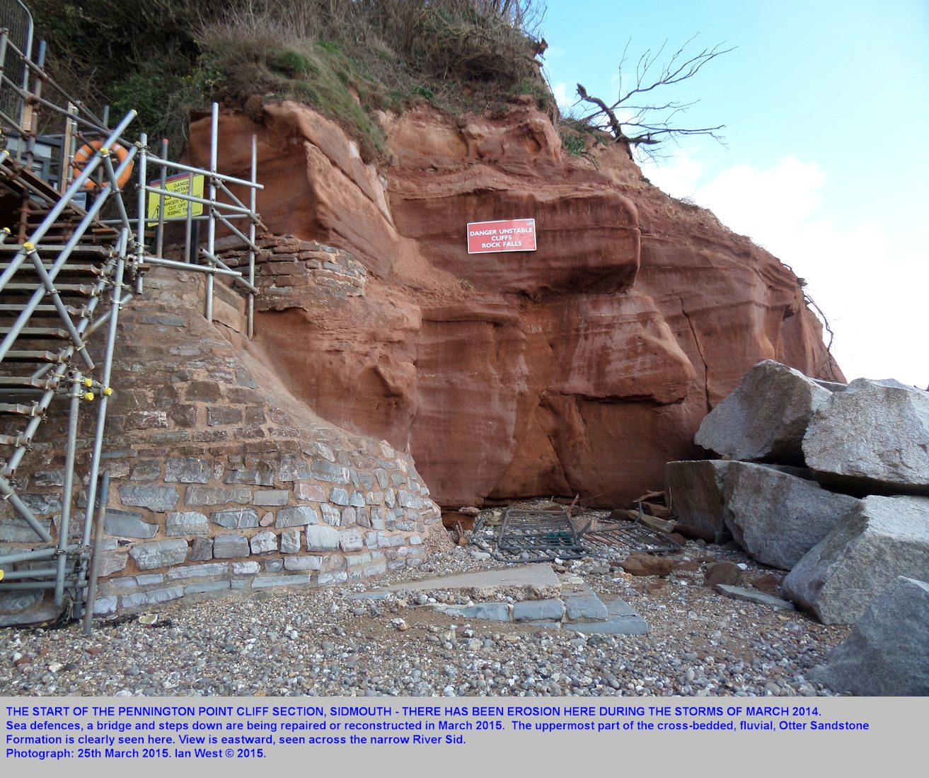 The first exposure of the Otter Sandstone, eastward from Sidmouth, Devon, across the footbridge and down some steps to the beach, seen in 2015 under repair after 2014 storm damage