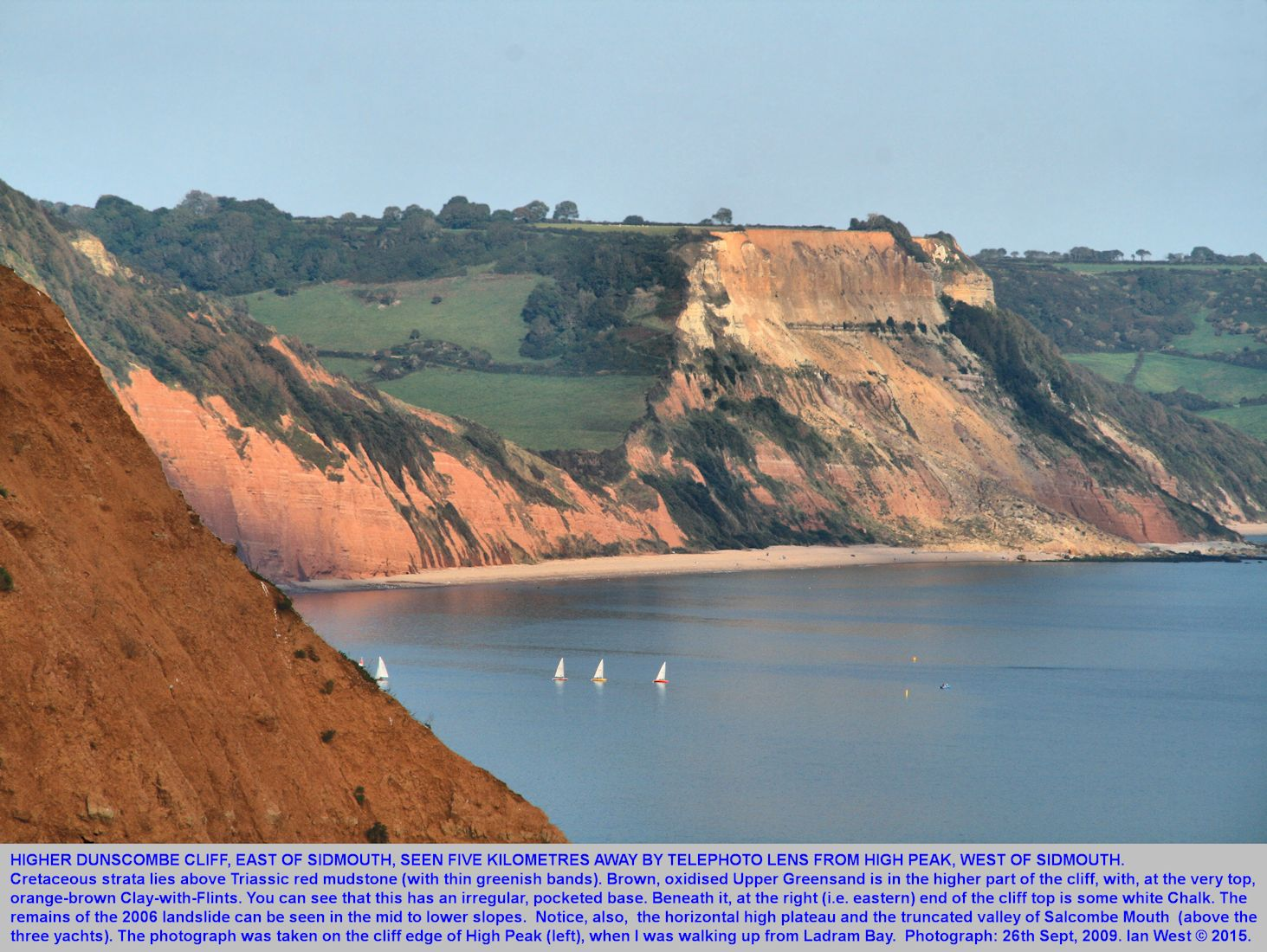 The cliff of Higher Dunscombe Hill, east of Sidmouth, seen at a distance from High Peak, west of Sidmouth, Devon