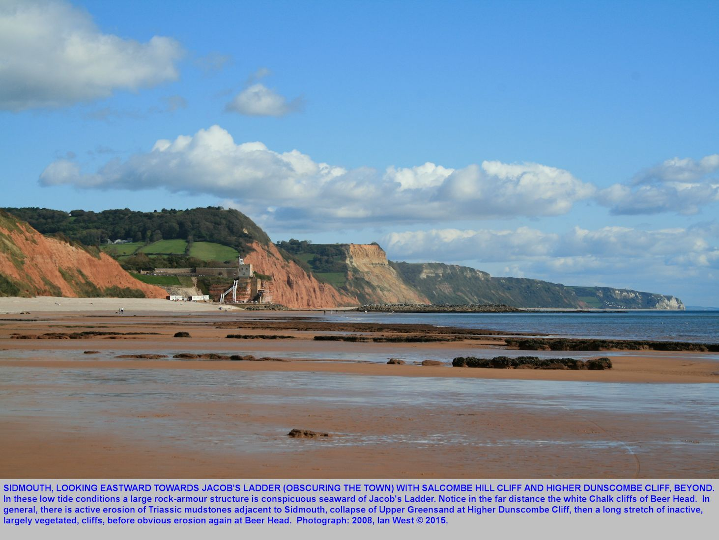 Sidmouth, a view eastward at low tide of Jacobs Ladder and the cliffs to the east of the town, including Salcombe Hill Cliff, Higher Dunscombe Cliff and on to Beer Head