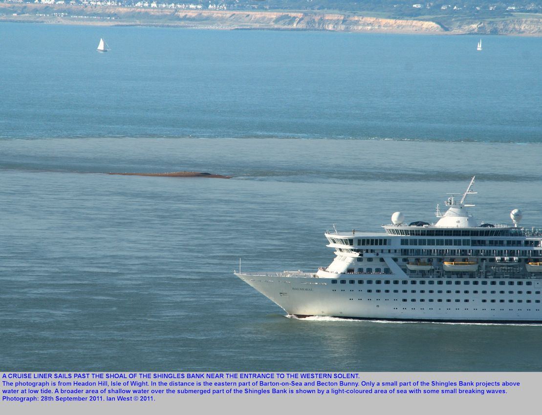 A cruise ship passes the Shingles Bank, at the entrance to the West Solent, southern England