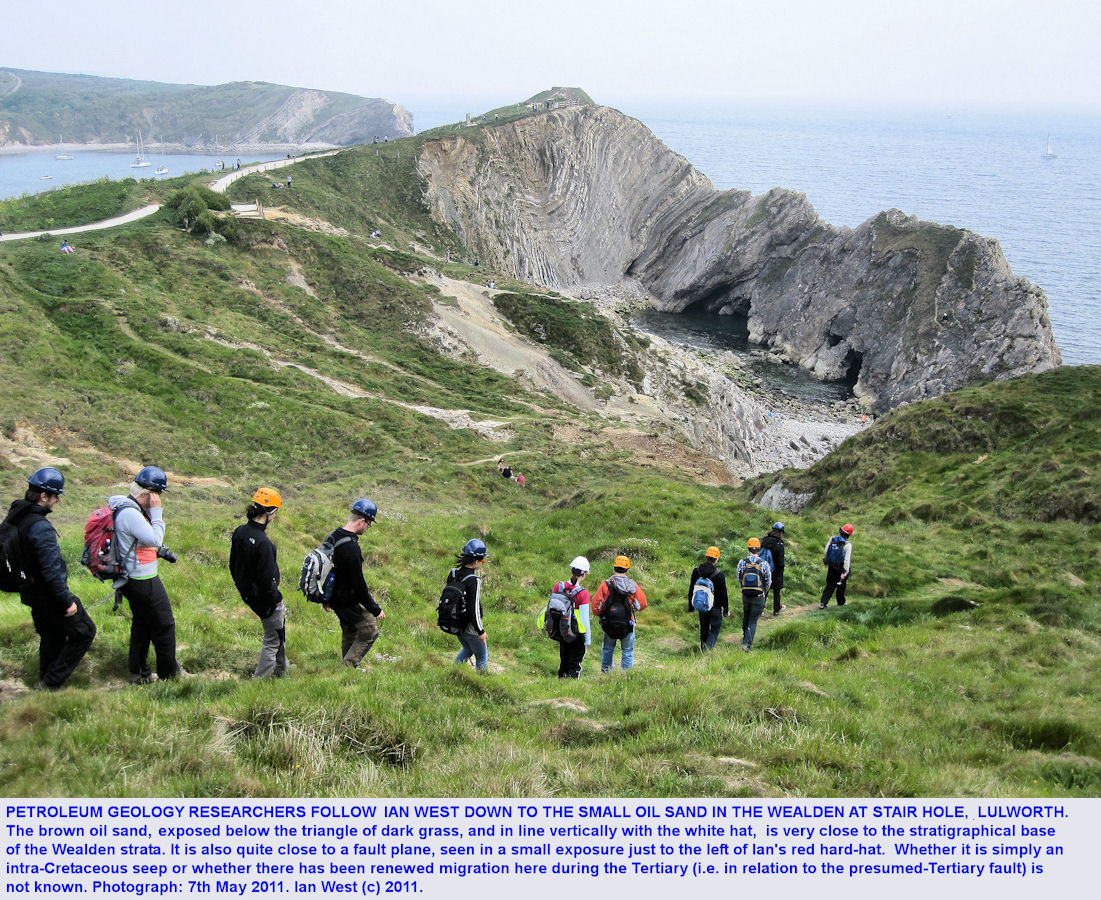 Petroleum geology researchers walk down into Stair Hole, near Lulworth Cove,  Dorset, to see the Wealden oil sand, 2011