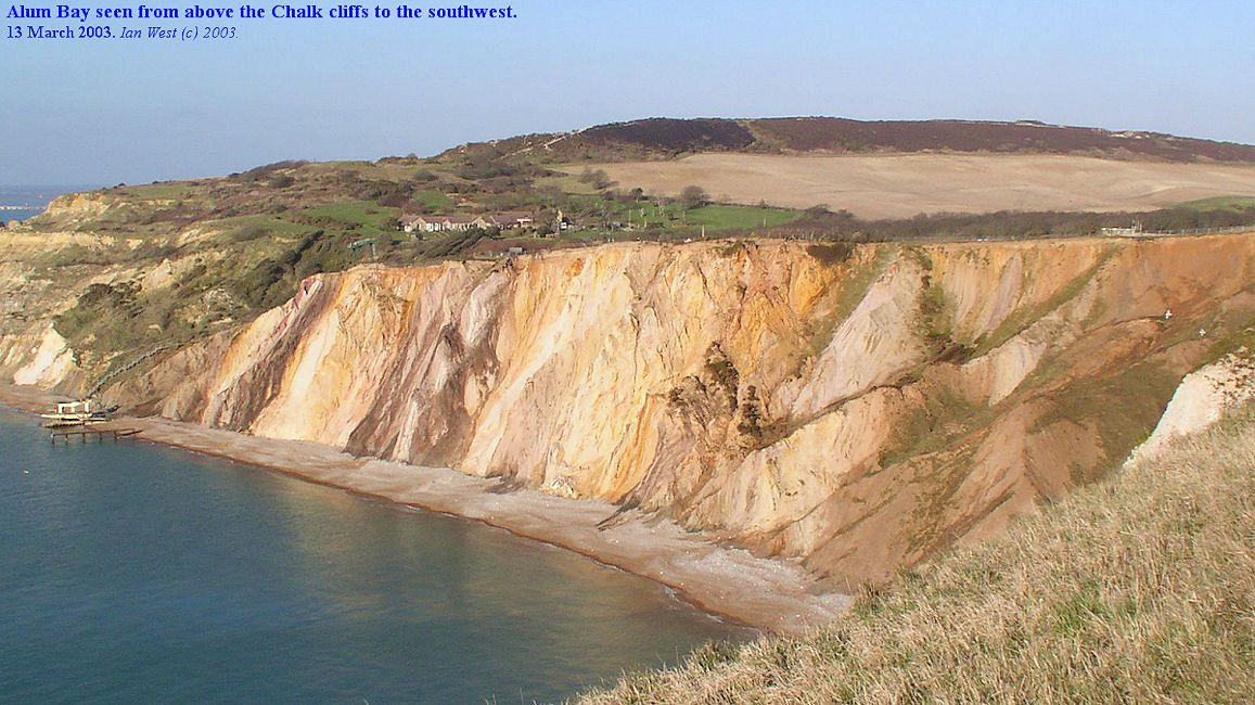 Vertical Tertiary strata with distinctive colouring seen in the Alum Bay cliffs from the southwest Chalk hills, 2003, image revised July 2016