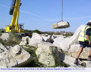 Slab with dinosaur footprints is swung away, Isle of Portland, Dorset